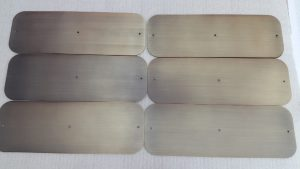 Brunitura spazzolatura e verniciatura di protezione previo ottonatura a spessore di lamiere in acciaio - Consonni